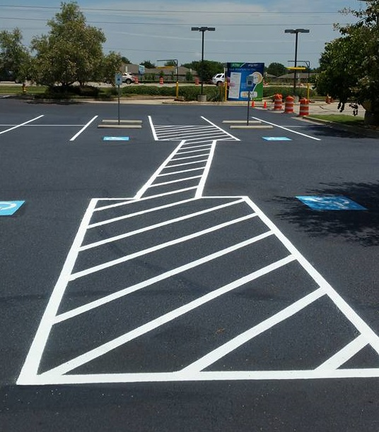 A Picture of an Asphalt Parking Lot.