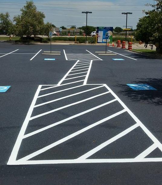 A Picture of an Asphalt Parking Lot.