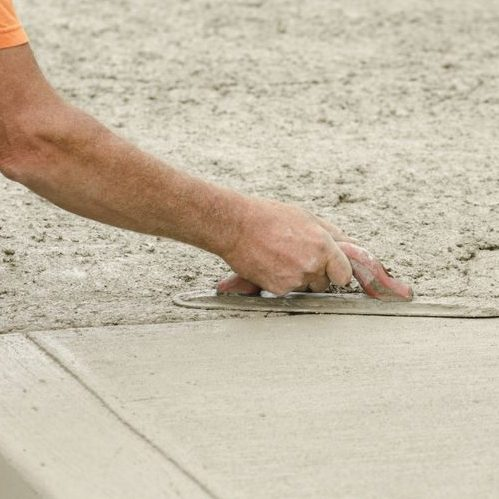 A Picture of a Contractor Installing New Concrete Sidewalk.