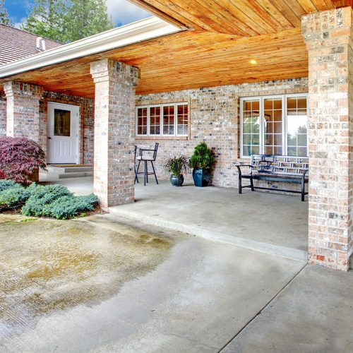 A Picture of a Patio Area with Concrete Floor.