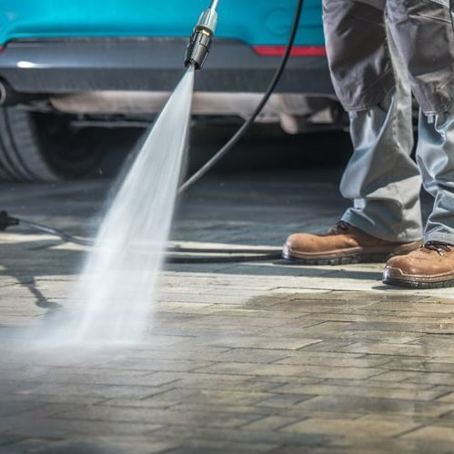 A Picture of Pressure Washing On a Driveway.