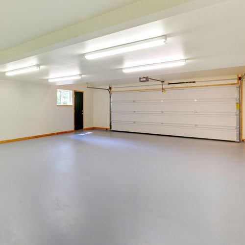 A Picture of a White Empty Garage.