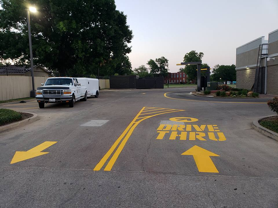 A Picture of a Yellow Drive Thru Painted On Ground.